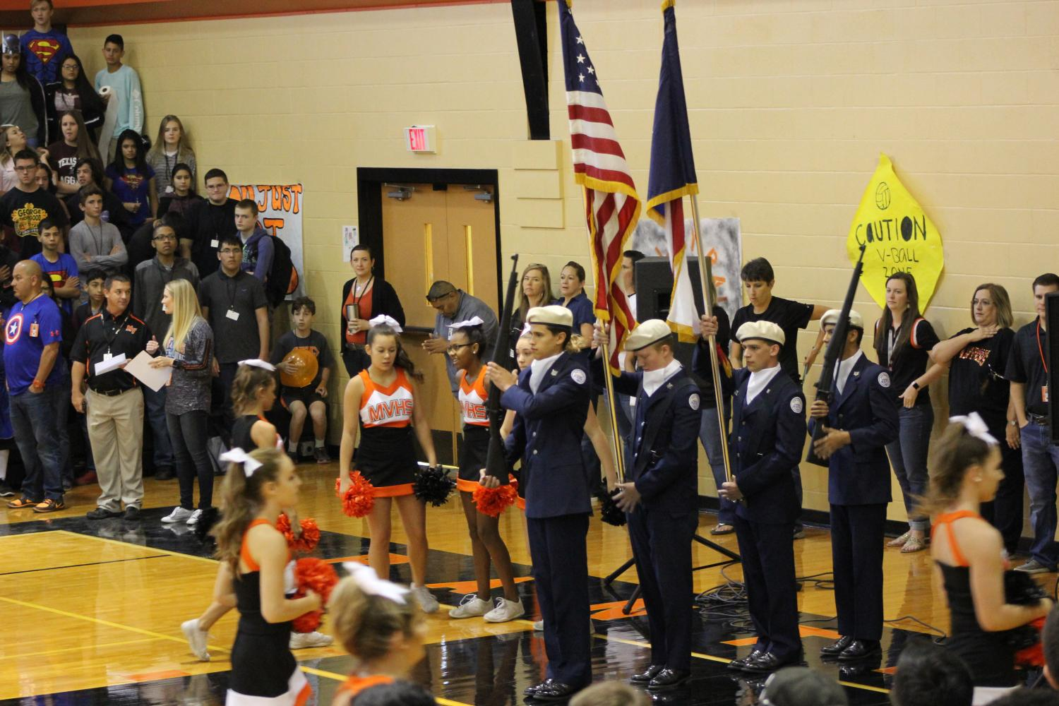 (Drill team performing at a pep rally. Jace Mills, Thomas Cook, Blake Corlis, Devin Reyna. PC: Yearbook)