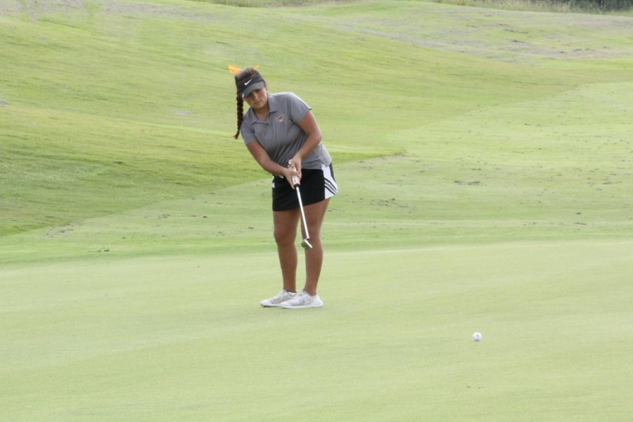 Stephine Vela,12, putting on hole number 9 green at Golf Club of Texas in the Regional Preview two day tournament.
