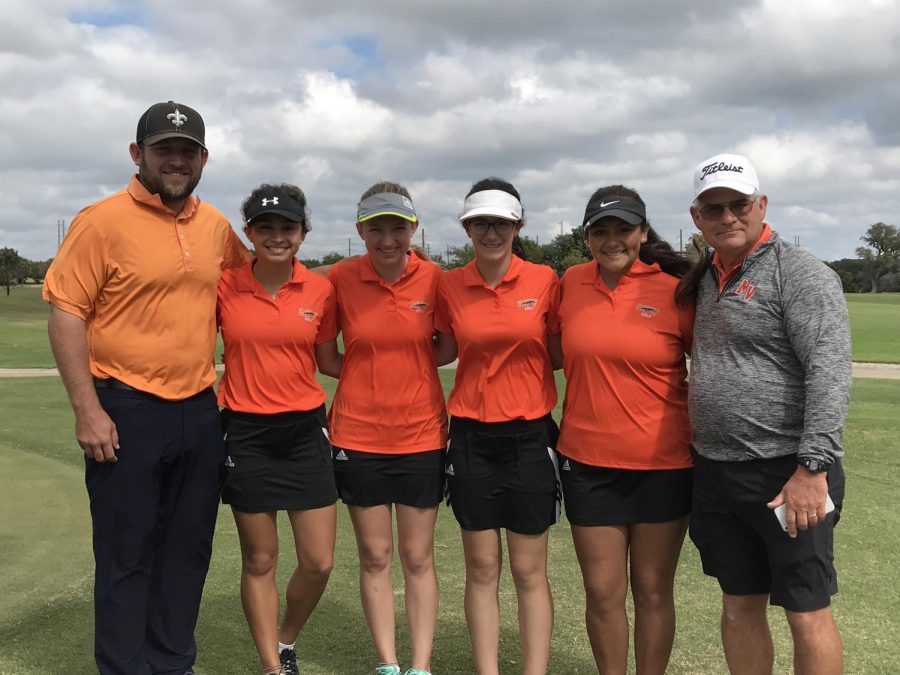 Coach Pricthard, Gabriela McNelly,10, Katie Scheiber,12, Ainsley Burns,9, Stephanie Vela,12, and Coach Kwapich  at the NISD Clark G Hill Country Classic at the Buckhorn Golf Course.