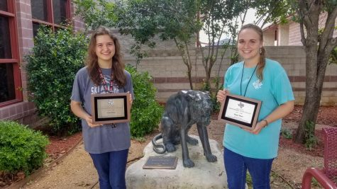 Students Clara Ham and Tanya Theis pose in front of their school after being awarded by TASSP for their academic and community accomplishments.
