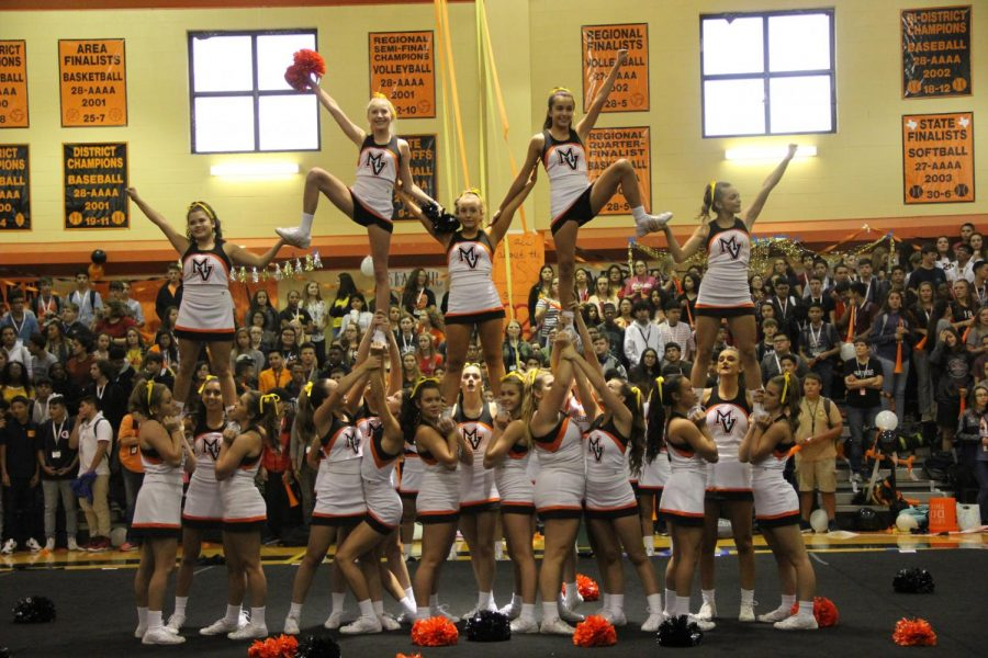 The MVHS cheerleaders posing at the end of their Pep Rally performance