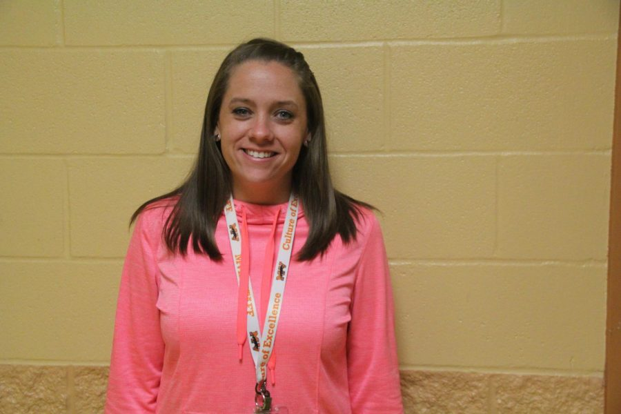 Ms. Wheatley poses outside of her classroom.  PC Mackenzie Noakes