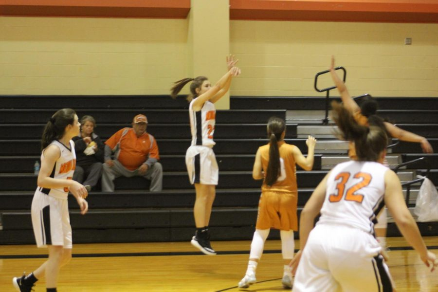 Kamryn Griggs attempts a jump shot to keep their team in the lead.