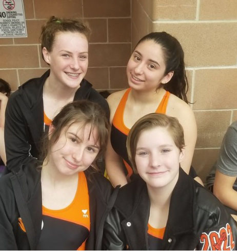 The Women's 200 Medley Team beaming while making history at District.