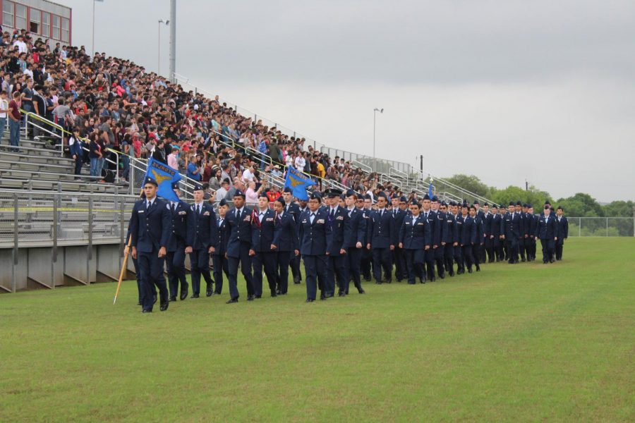 JROTC+marching+in+step+of+one+another+during+their+2019+Pass+in+Review