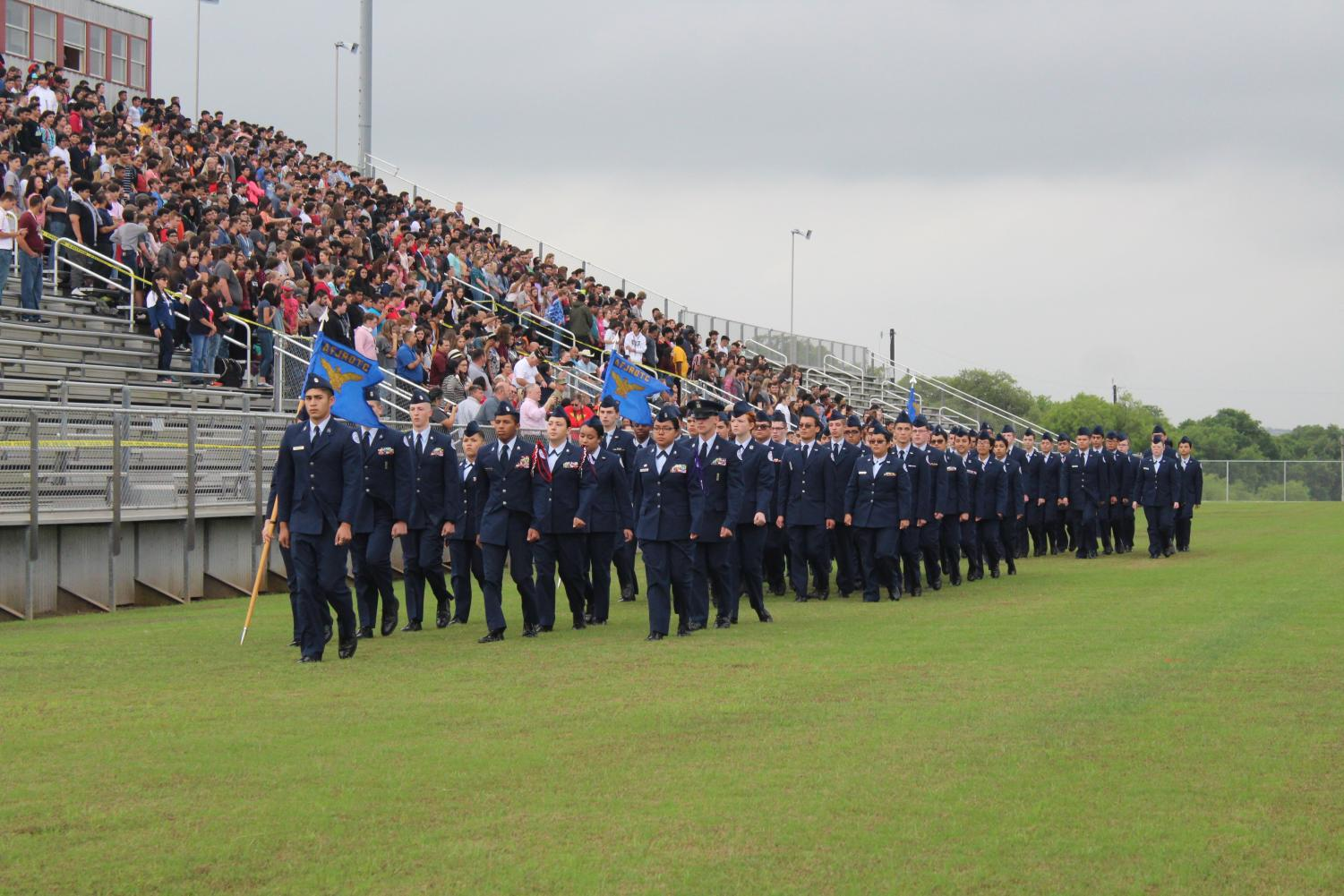 JROTC marching in step of one another during their 2019 Pass in Review