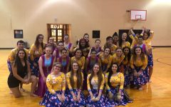 Color Guard together, sporting Spring colors and flowers.