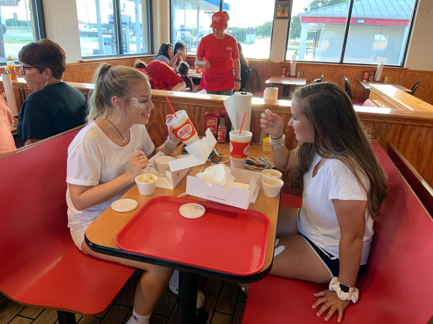 Juniors Kennedy Kroum and Emyrson Purdy enjoy  a meal at Bush's before the Lockhart home game
