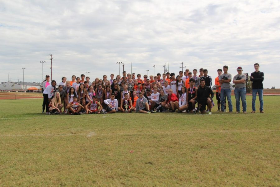 The whole cross country team after the meet with all their awards form the day.