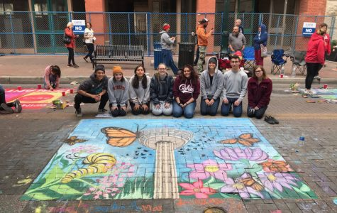 The art students pose with their wonderful chalk artwork. From left to right: Max Leal, Sohpia Argullies, Allie Schott, Kerian Downs, and Maddie Rosario.