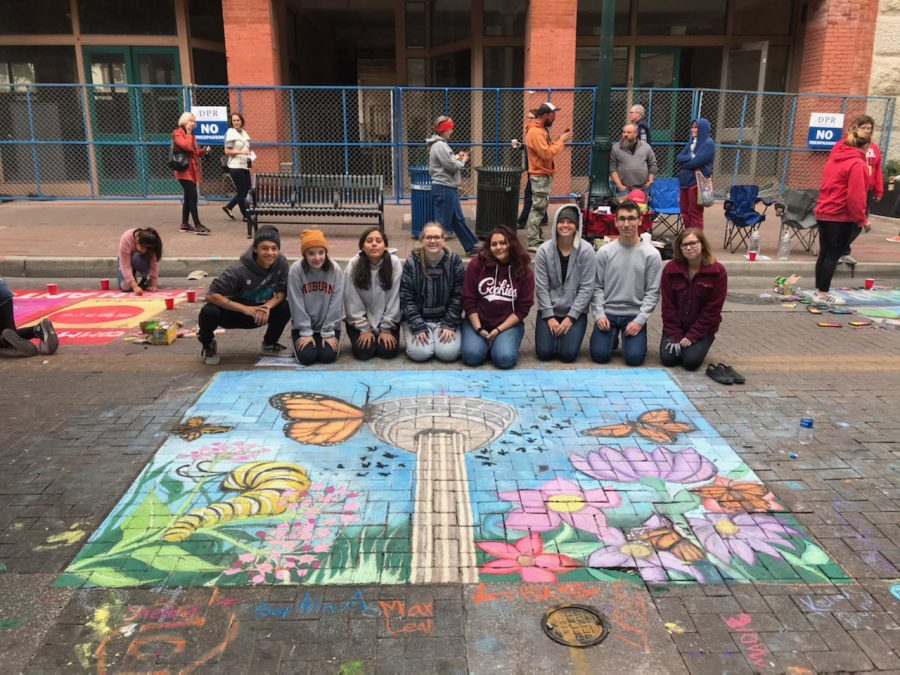 The+art+students+pose+with+their+wonderful+chalk+artwork.+From+left+to+right%3A+Max+Leal%2C+Sohpia+Argullies%2C+Allie+Schott%2C+Kerian+Downs%2C+and+Maddie+Rosario.+