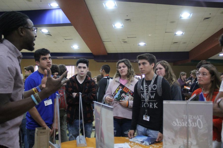 Medina Valley juniors around Prescott University's college fair table. Having to start applying to colleges by the end of the year, these students are focused and ready to take in as much as they can.