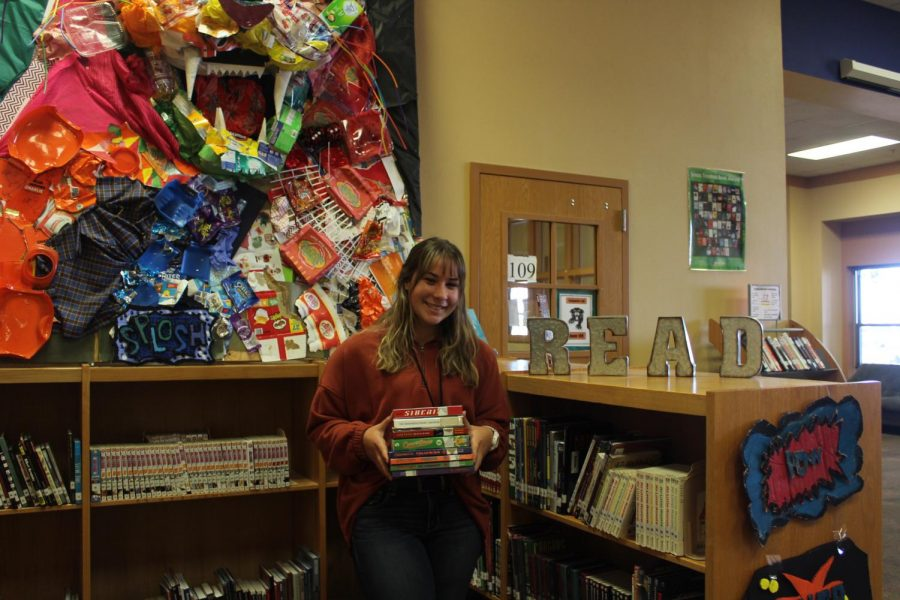 Senior Karlee Kindred stacks up on the newest free books at the library!