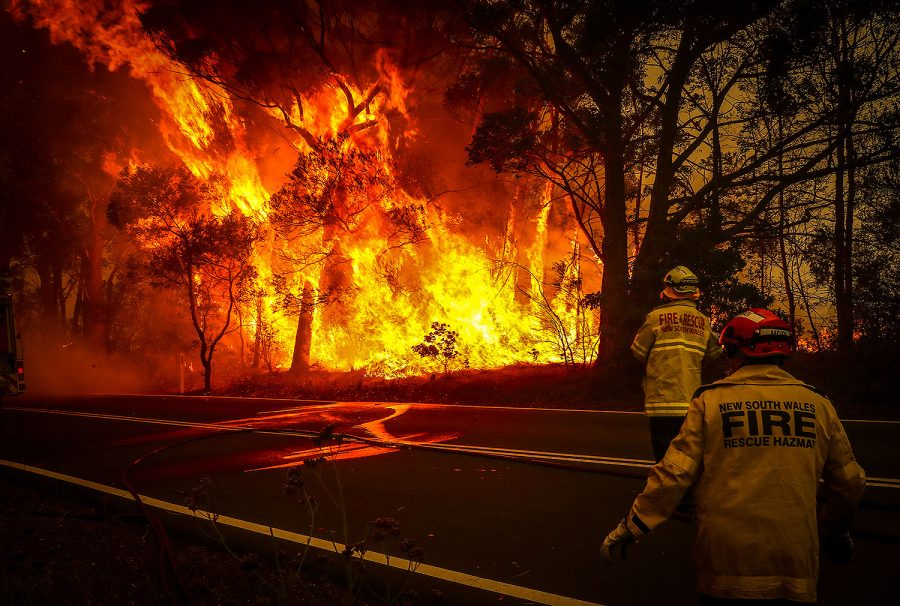SYDNEY, AUSTRALIA - DECEMBER 19: Fire and Rescue personal watch a bushfire as it burns near homes on the outskirts of the town of Bilpin on December 19, 2019 in Sydney, Australia.   (Photo by David Gray/Getty Images)