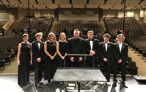 Eight of our band students with the director of bands after the region concert. Left to right: Grace Simonson (11), Nathaniel Martin (10), Koree Valencia (12), Sara Guinn (12), Anthony Zinsmeyer (11), Juan Madrigal (10), Tyler Oberhauser (12). Not pictured: Lilia Martinez (12).