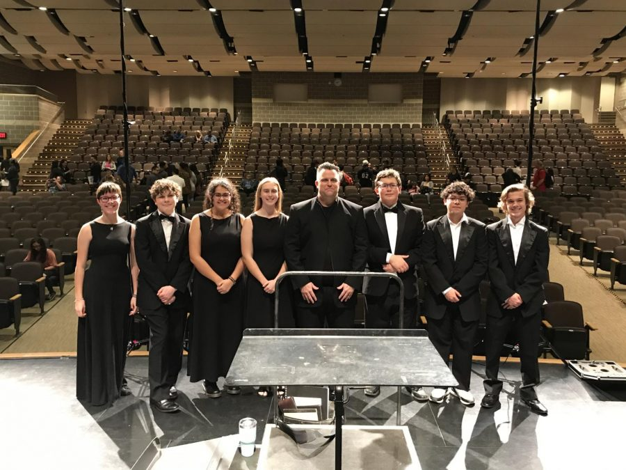 +Eight+of+our+band+students+with+the+director+of+bands+after+the+region+concert.+Left+to+right%3A+Grace+Simonson+%2811%29%2C+Nathaniel+Martin+%2810%29%2C+Koree+Valencia+%2812%29%2C+Sara+Guinn+%2812%29%2C+Anthony+Zinsmeyer+%2811%29%2C+Juan+Madrigal+%2810%29%2C+Tyler+Oberhauser+%2812%29.+Not+pictured%3A+Lilia+Martinez+%2812%29.