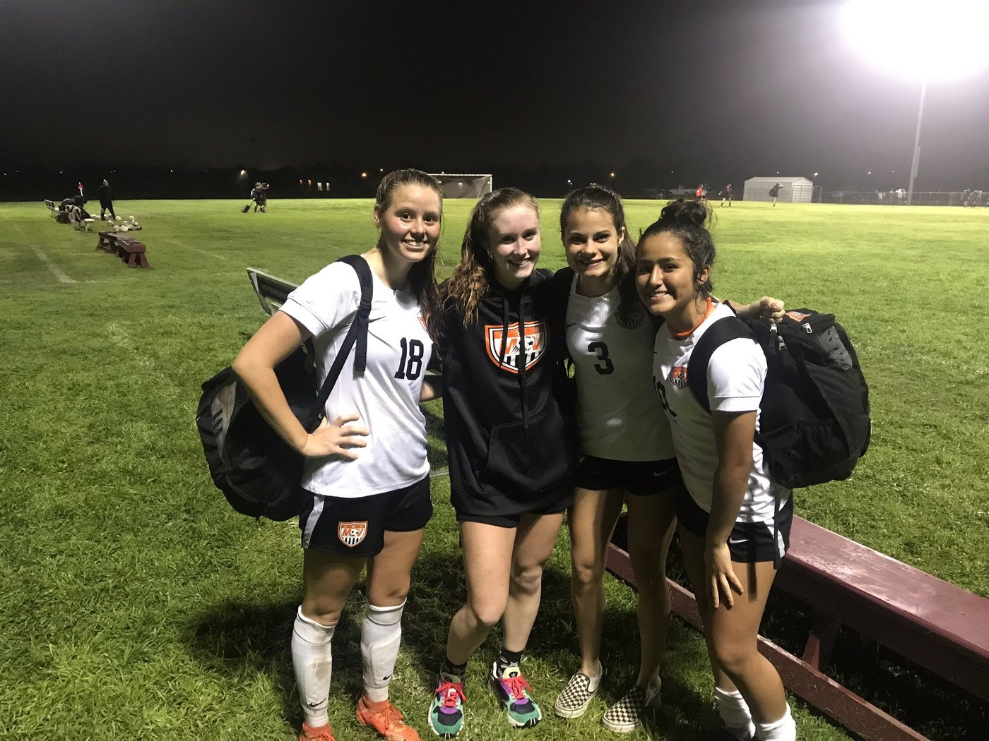 Left to Right)Senior Alee Schott, senior Audra Clark, senior Regan Lewis, and sophomore Nadia Reyna together smiling after a win.