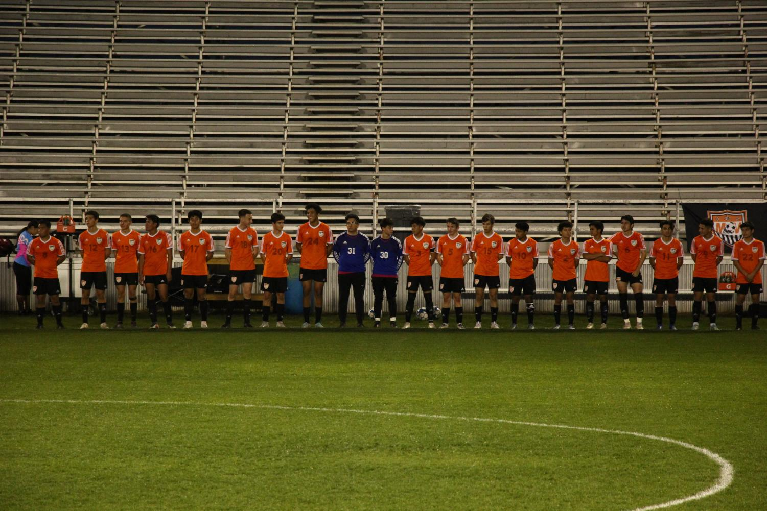 The team lines up before the game on Feb 4