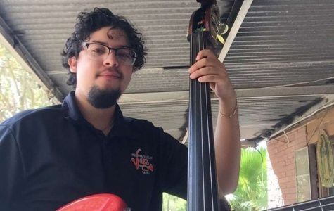 Madrigal with his bass guitar and stand up bass