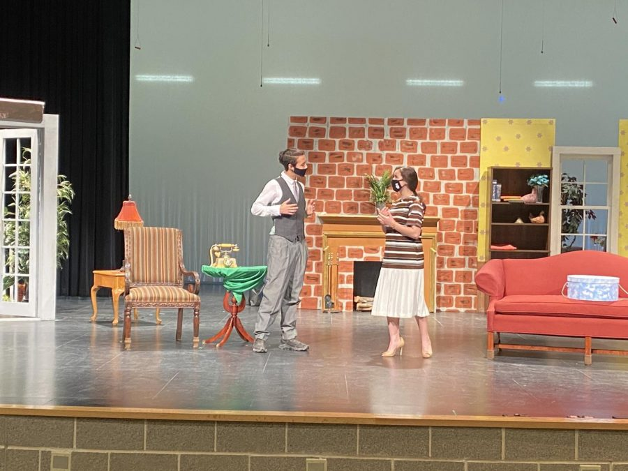 Junior Travis Schindler and sophomore Gabrielle Wilson in scene.