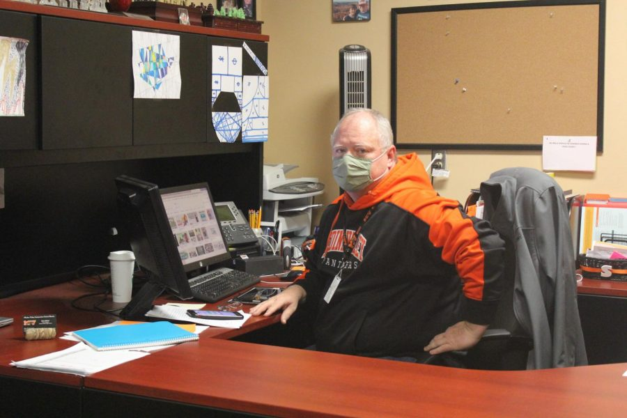 Mr. Slaton working in his office
